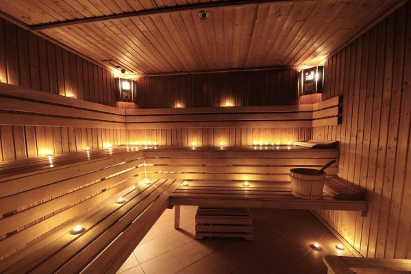 Warm finnish sauna interior with candles